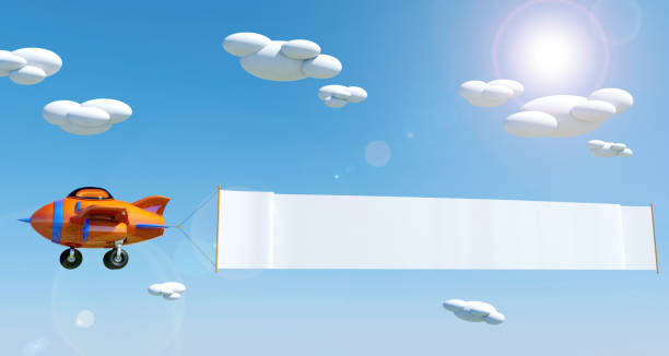 Cartoon airplane flying with empty advertising banner under blue sky stock photo