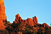 The Snoopy Dog cartoon and comics character in iconic pose of laying on top of dog house contemplating the universe Sedona Arizona USA.  In the Munds Mountain Wilderness Area.  At sunset on warm spring day.  Variant.