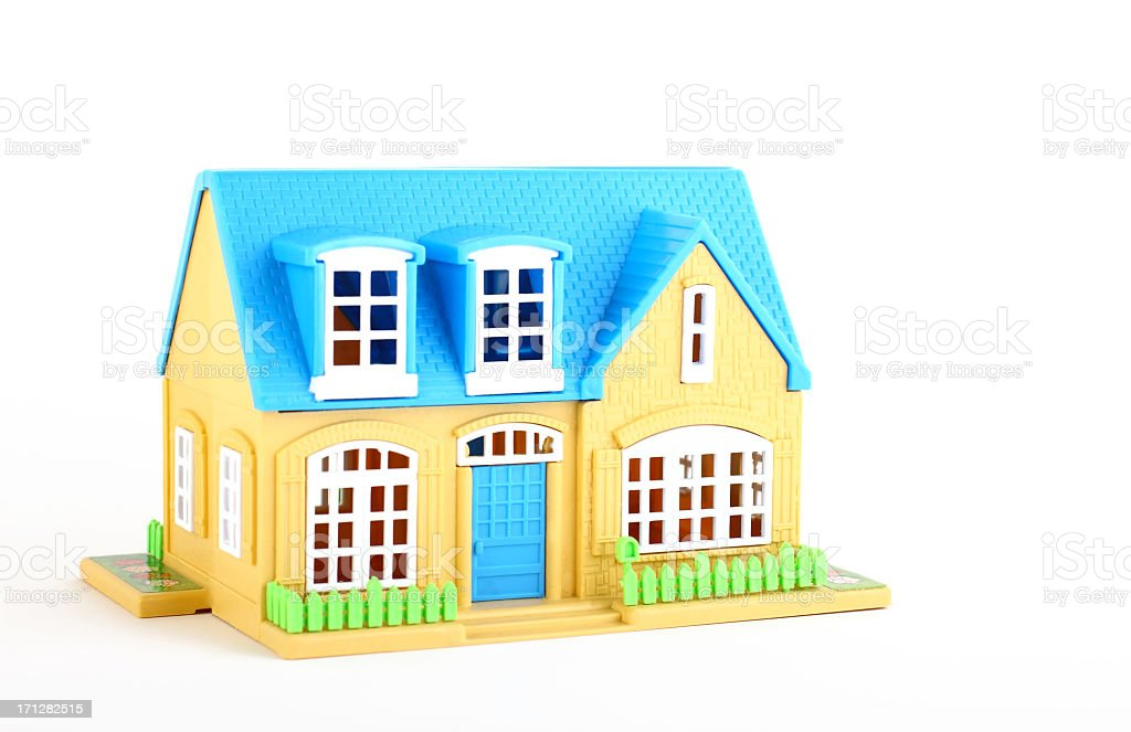 A cartoon image of a blue and yellow house stock photo