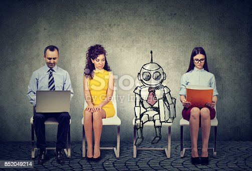 istock Cartoon robot sitting in line with applicants for a job interview 852049214