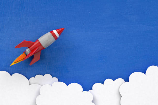 3d cartoon rocket on painted blue background with clouds - mphillips007 stock pictures, royalty-free photos & images