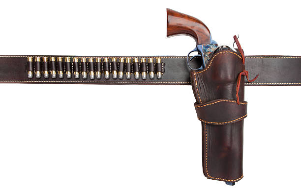 cartridge belt with holster, gun, and ammunition stock photo