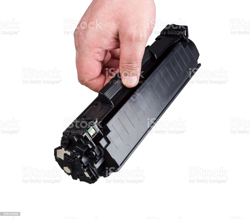 Cartridge for printer in hand stock photo