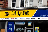 London, England - May 8, 2011: Signs on a Cartridge World shop in the London suburbs. Cartridge World refills and remanufactures inkjet and toner cartridges and has over 1,600 franchised retail outlets worldwide.