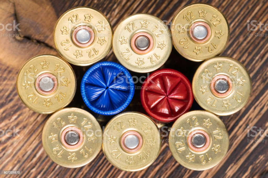 Cartridges from a hunting rifle background concept stock photo
