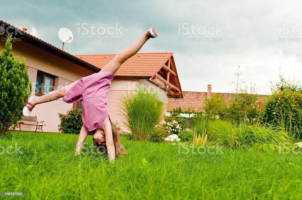 Cartwheel -fun on garden stock photo