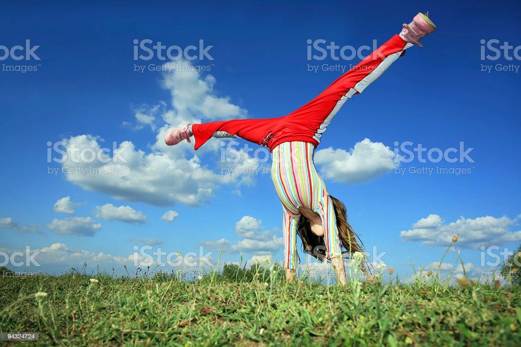 Cartwheel on meadow stock photo