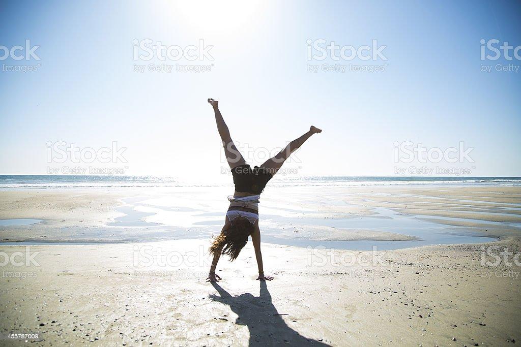 Cartwheels on the Beach stock photo