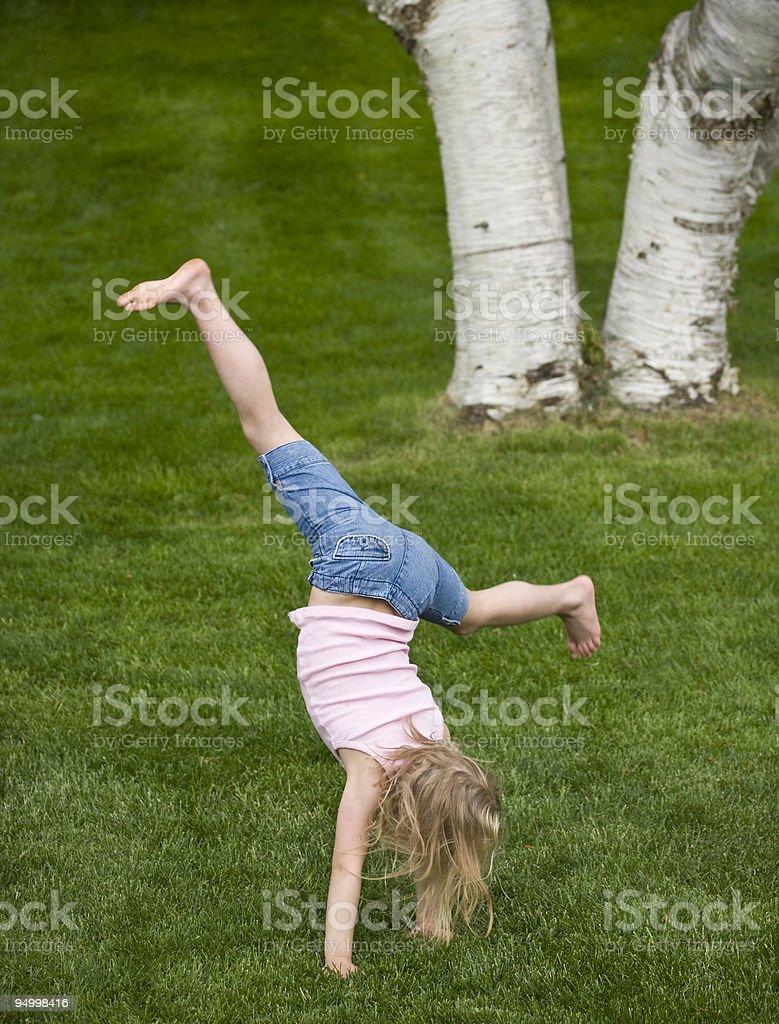 Cartwheels on the grass stock photo