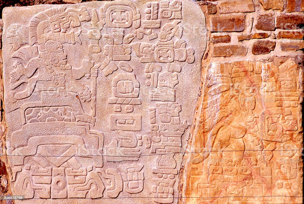 carved bas-relief stones by Zapotec peoples at Monte Alban ruins Oaxaca Mexico stock photo