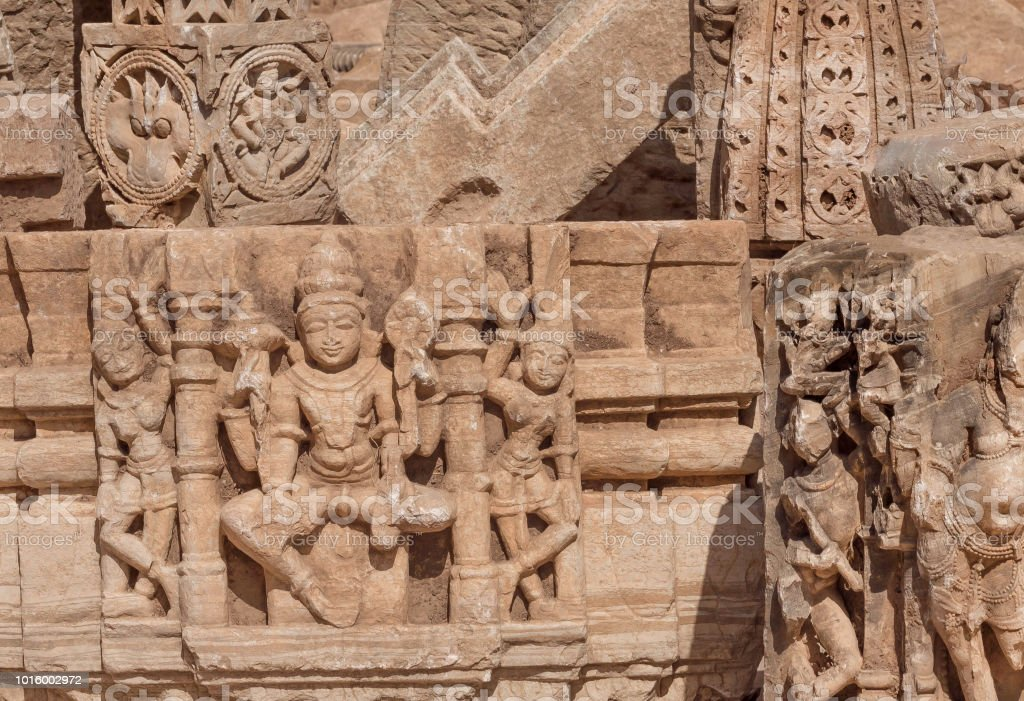 Carved broken walls of Hindu temples with sculptures of Shiva lord and other, Chitaurgarh fort. Rajasthan of India. stock photo