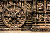 istock Carved chariot wheel on Konark Sun Temple, Odisha, India 1068995964