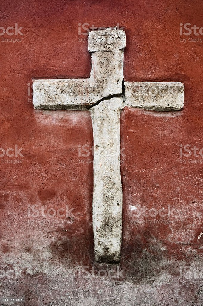 Carved cross (crucifix) on wall royalty-free stock photo