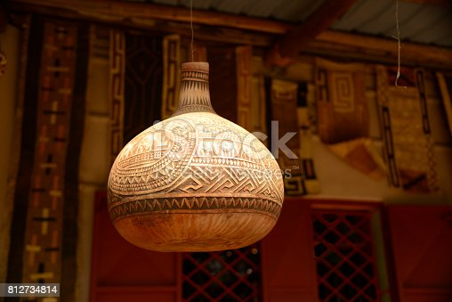 istock Carved decorative African gourds hanging on post 812734814