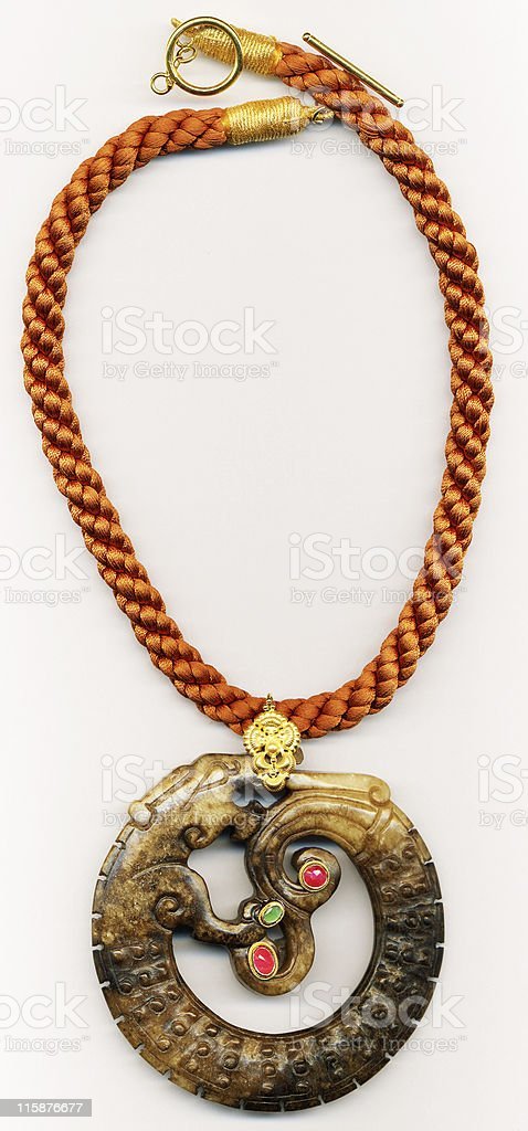 Carved dragon pendant royalty-free stock photo