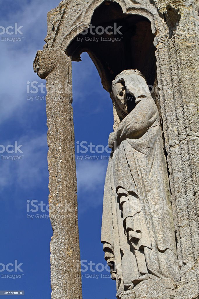 Carved figure from the Eleanor cross stock photo