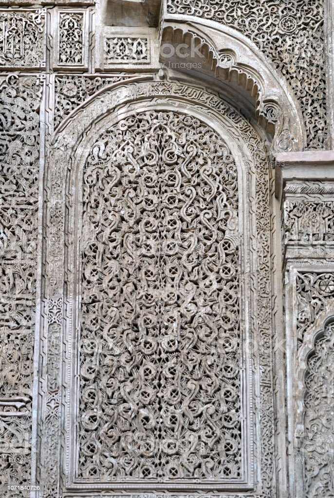 Carved floral pattern on the walls in Madrasa Bou Inania stock photo