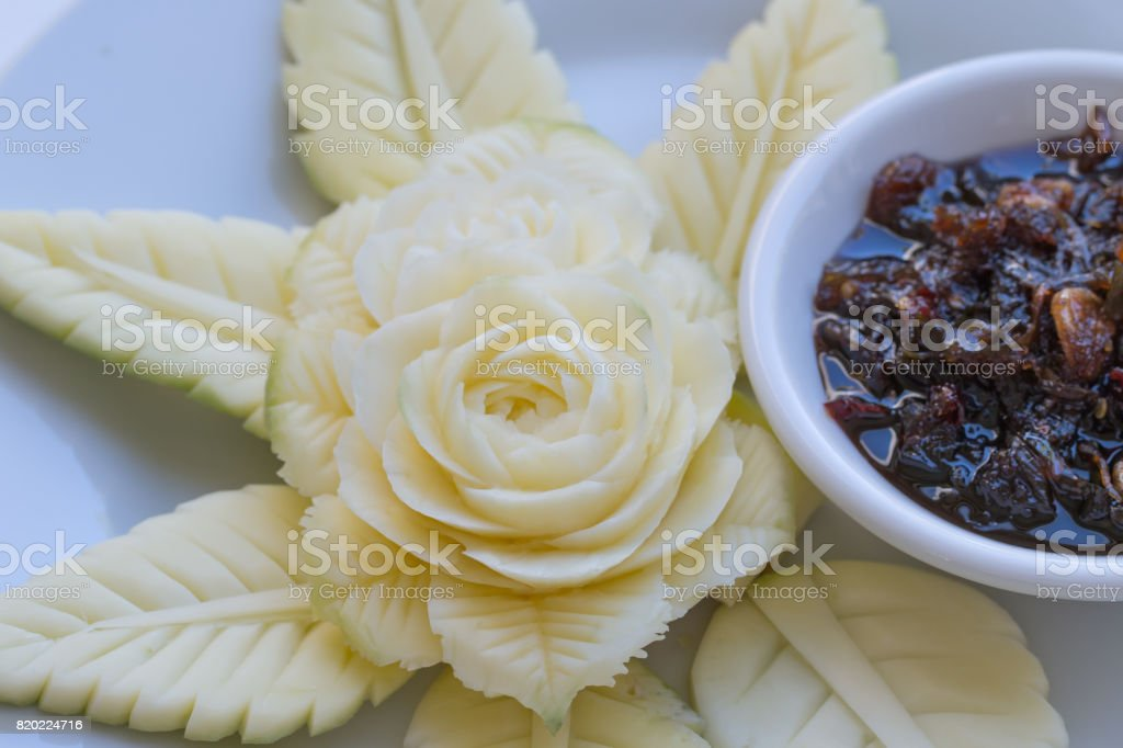 Carved Green Mandgoes with Sweet fish sauce. stock photo