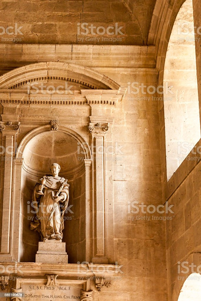 Carved indoor statue stock photo