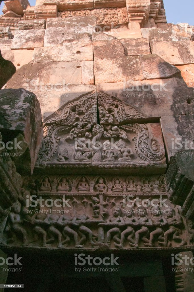 Carved pediment depicting a Hindu mythology of Churning of the Ocean of Milk at the Wat Ek Phnom a 11th century angkorian temple stock photo