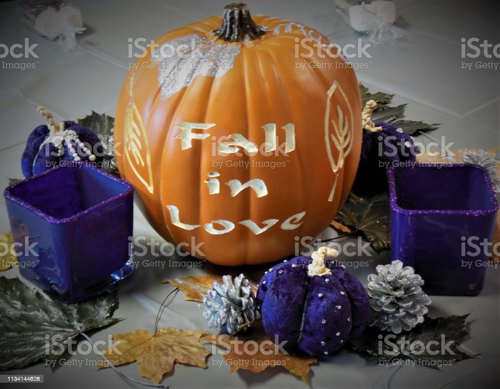 Carved pumpkin for fall wedding