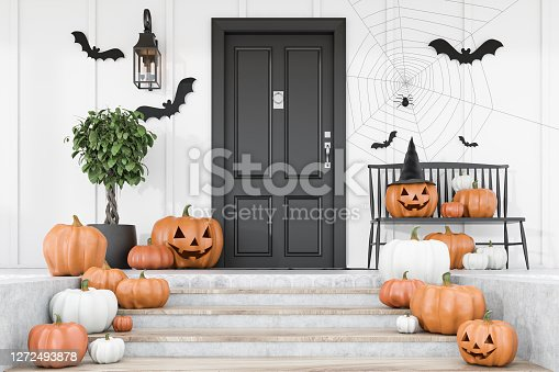 istock Carved pumpkins on stairs of white house 1272493878