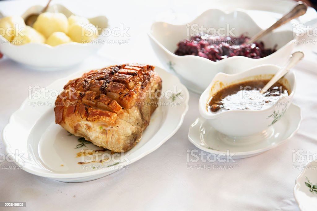 Carved roast pork on a plate stock photo