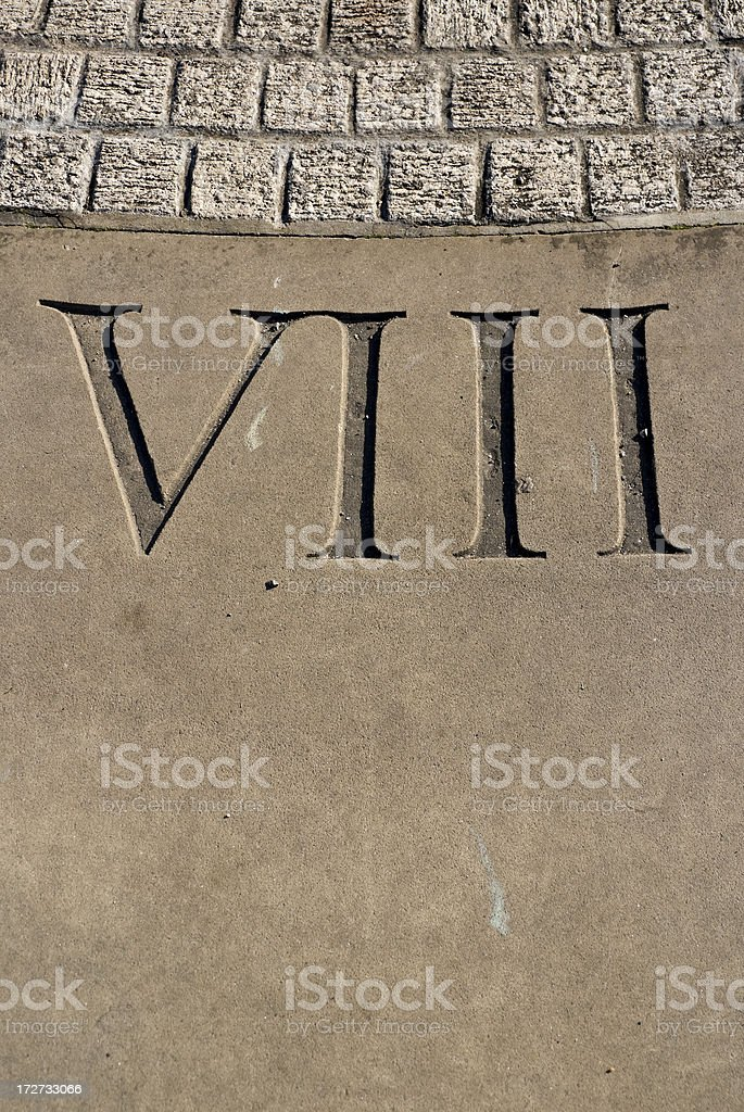 Carved Roman numeral VIII on sundial stock photo