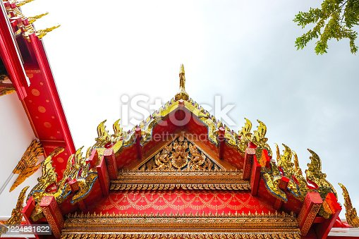 Carved roof around Wat Pho 'Temple of the Reclining Buddha' Bangkok Thailand.