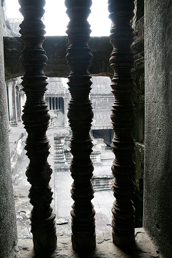Carved sandstone spindles in a window. Angkor - UNESCO World Heritage site, Cambodia.