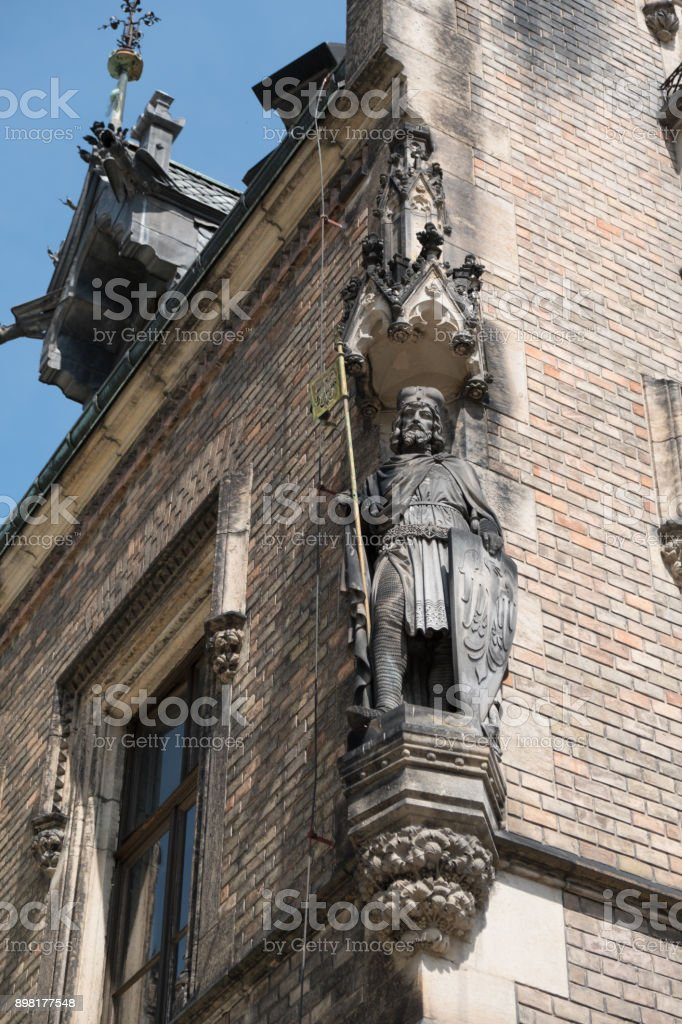Carved statue of Saint George in the niche of New Provost's Lodging near Prague Castle in St George's Square, Prague. stock photo