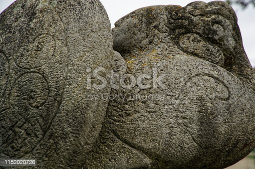 istock Carved stone - ancient inscription and nature lines ornate 1152020726