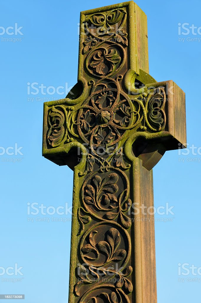 Carved stone celtic cross in a Scottish cemetry royalty-free stock photo