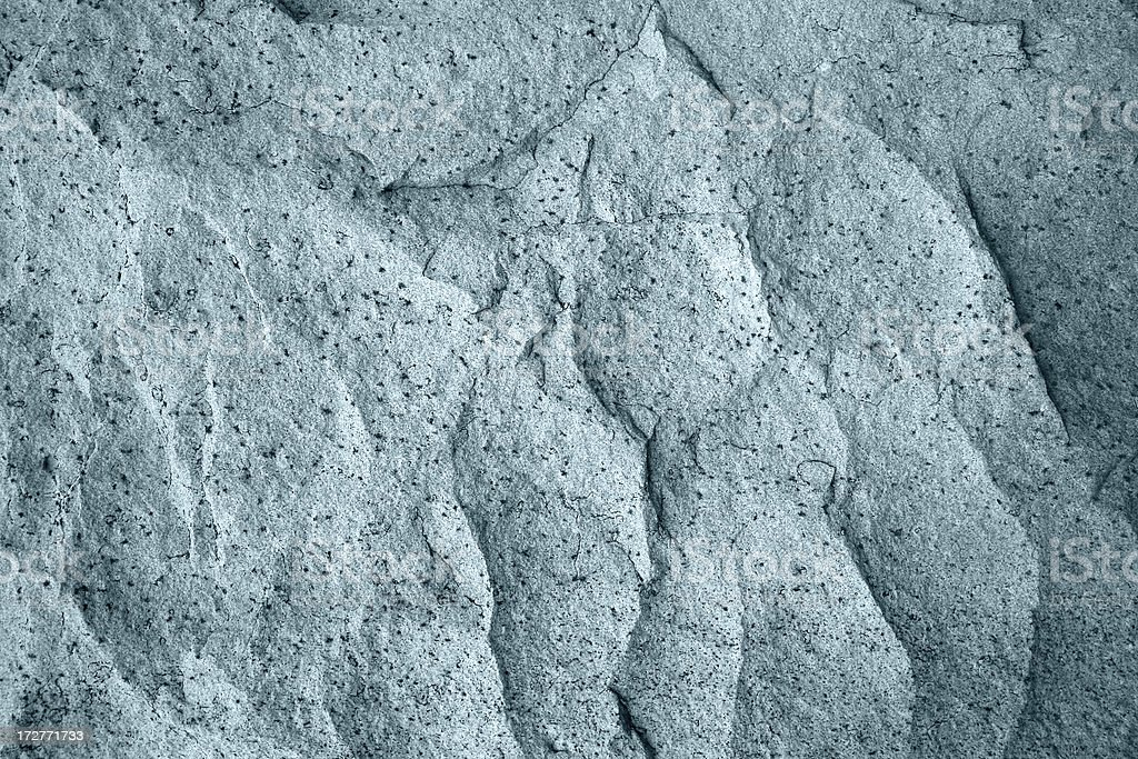 Carved Stone Texture Tinted Blue stock photo