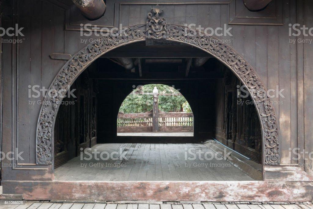 Carved Teak Archway, Shwe In Bin Kyaung Monastery, Mandalay, Myanmar (Burma) stock photo