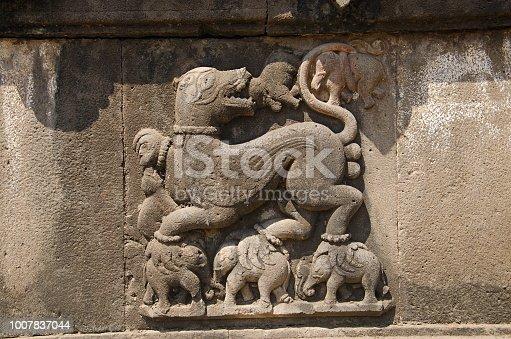 istock Carved wall showing a sharabha lifting elephants in its bare paws. Dakshin Kashi Mandir. Mahuli Sangam. Satara. Maharashtra. India 1007837044