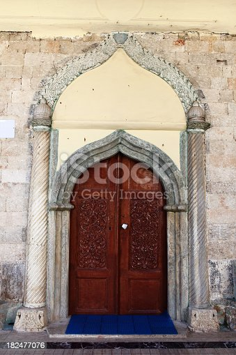 Ornate door entrance to a house in historical Kaleici, Antalya. Also known as Old Antalya at the center of the sprawling modern city was the Roman town, then the Byzantine, then the Seljuk Turkish, and finally the Ottoman Turkish town.