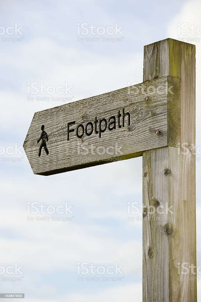Carved wooden footpath direction sign in rural Scotland royalty-free stock photo