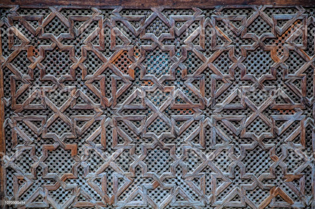 Carved wooden pattern in Madrasa Bou Inania wooded stock photo