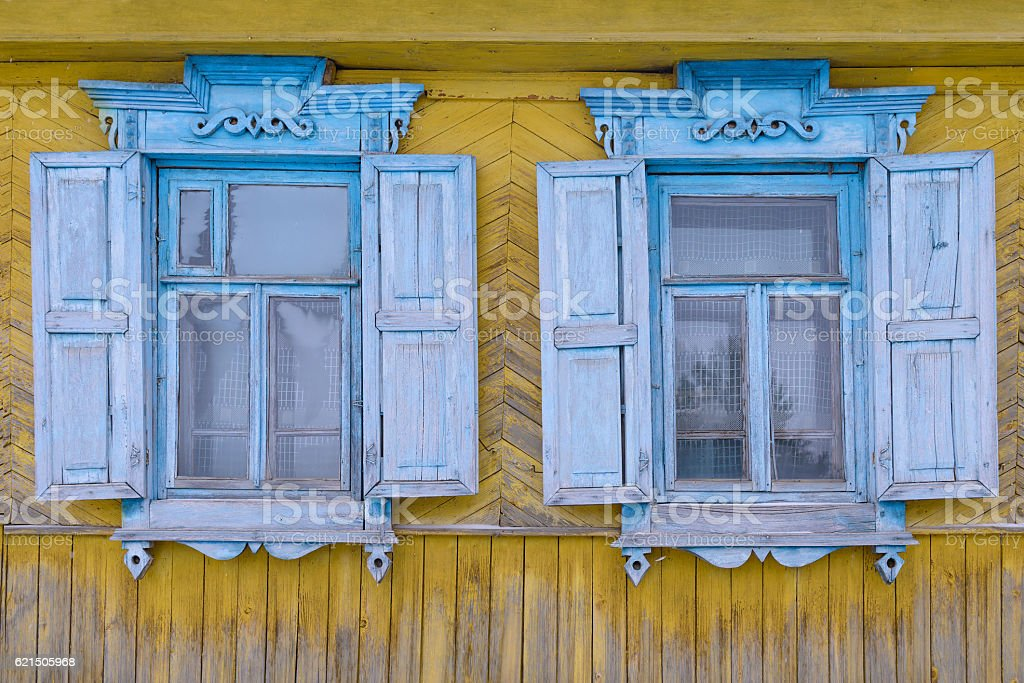 carved wooden shutters on the windows Lizenzfreies stock-foto