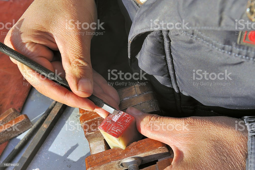 Carving a Chinese seal stock photo