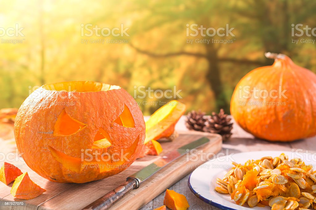 Carving a Jack O'Lantern for Halloween stock photo