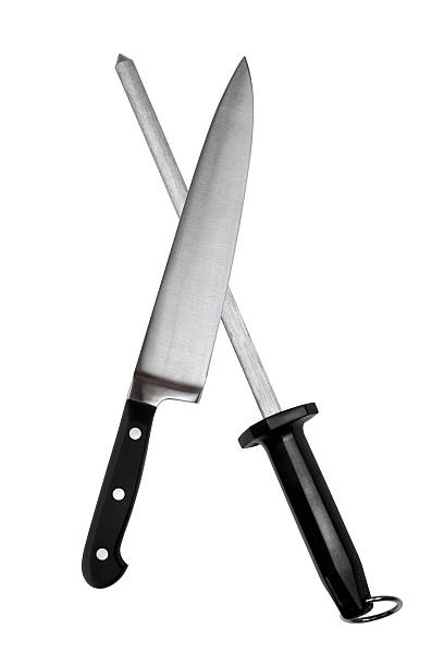Carving Knife and Sharpening Steel Carving knife and sharpening steel, isolated on white background. carving knife stock pictures, royalty-free photos & images