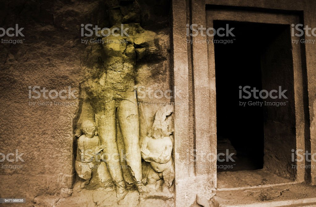 Carving on stone in the Elephanta Island Cave stock photo