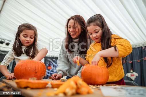 istock Carving Pumpkins with Mummy 1255954326