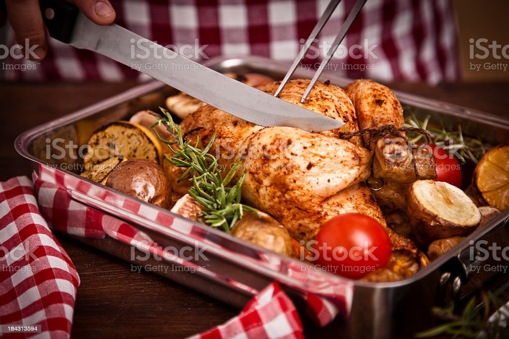 Carving Roast Chicken royalty-free stock photo