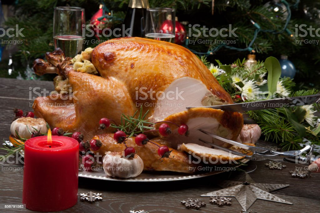 Carving Rustic Style Christmas Turkey stock photo