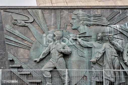 Bas-relief with soviet cosmonaut and scientists carved on the monument to the Conquerors of Space at the All-Russian Exhibition Center. Shooting at a winter on day, front view