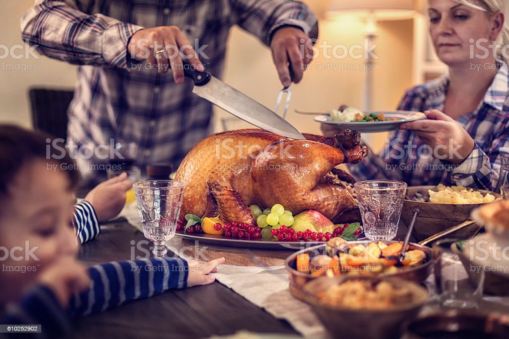 Carving Traditional Stuffed Turkey for Dinner stock photo