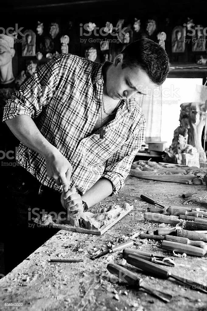 carving with chisel monochrome image stock photo